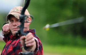 Male Archer Aiming at His Target